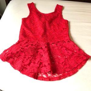 Sleeveless red peplum lace top